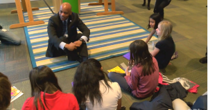 Denver Mayor Michael Hancock speaks with local students at the Denver Art Museum.